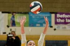 Amity's Zoe DiZenzo sets the ball in the Class LL championship game against Darien in 2018.