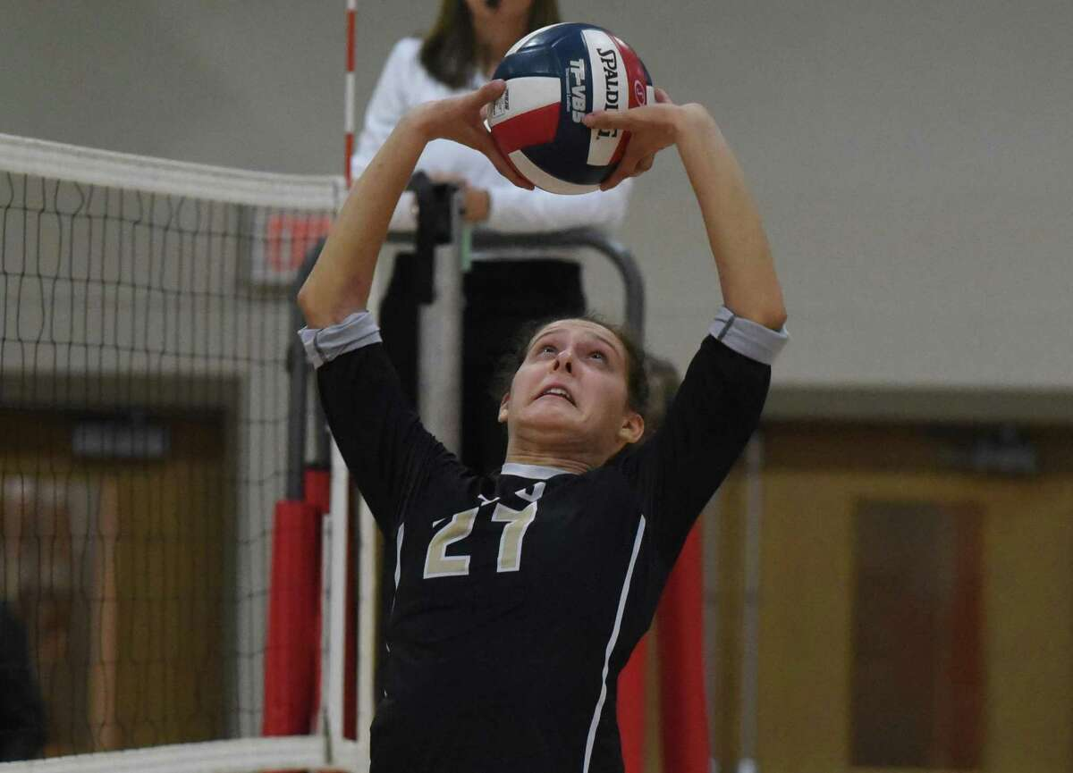 Trumbull's Ali Castro (27) sets the ball during a girls volleyball match in New Canaan on Thursday, Oct. 3, 2019.