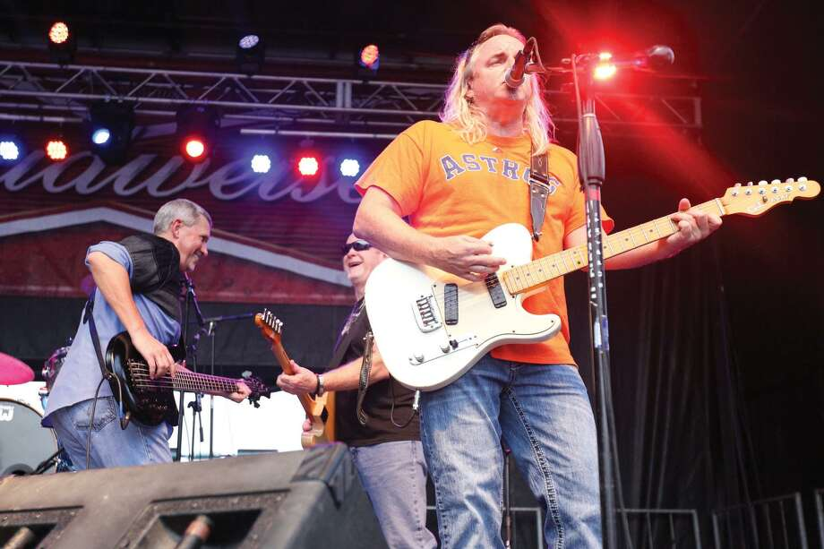 Bayou Roux performs on the Cajun Stage during the Conroe Cajun Catfish Festival on Friday night in downtown Conroe. Photo: Michael Minasi, Photographer