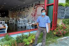 Wilson Rodriguez, co-owner of Pesca Peruvian Bistro at 70 Main St. in New Canaan, stood on the patio of the restaurant, which has large windows leading to the patio, an old fishing boat for atmosphere and large heaters outside.