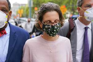 Clare Bronfman arrives at federal court, Wednesday, Sept. 30, 2020, in the Brooklyn borough of New York. Bronfman, the Seagram's liquor fortune heir and a wealthy benefactor of Keith Raniere, the disgraced leader of a self-improvement group NXIVM in upstate New York convicted of turning women into sex slaves who were branded with his initials, faces sentencing Wednesday in the federal conspiracy case.