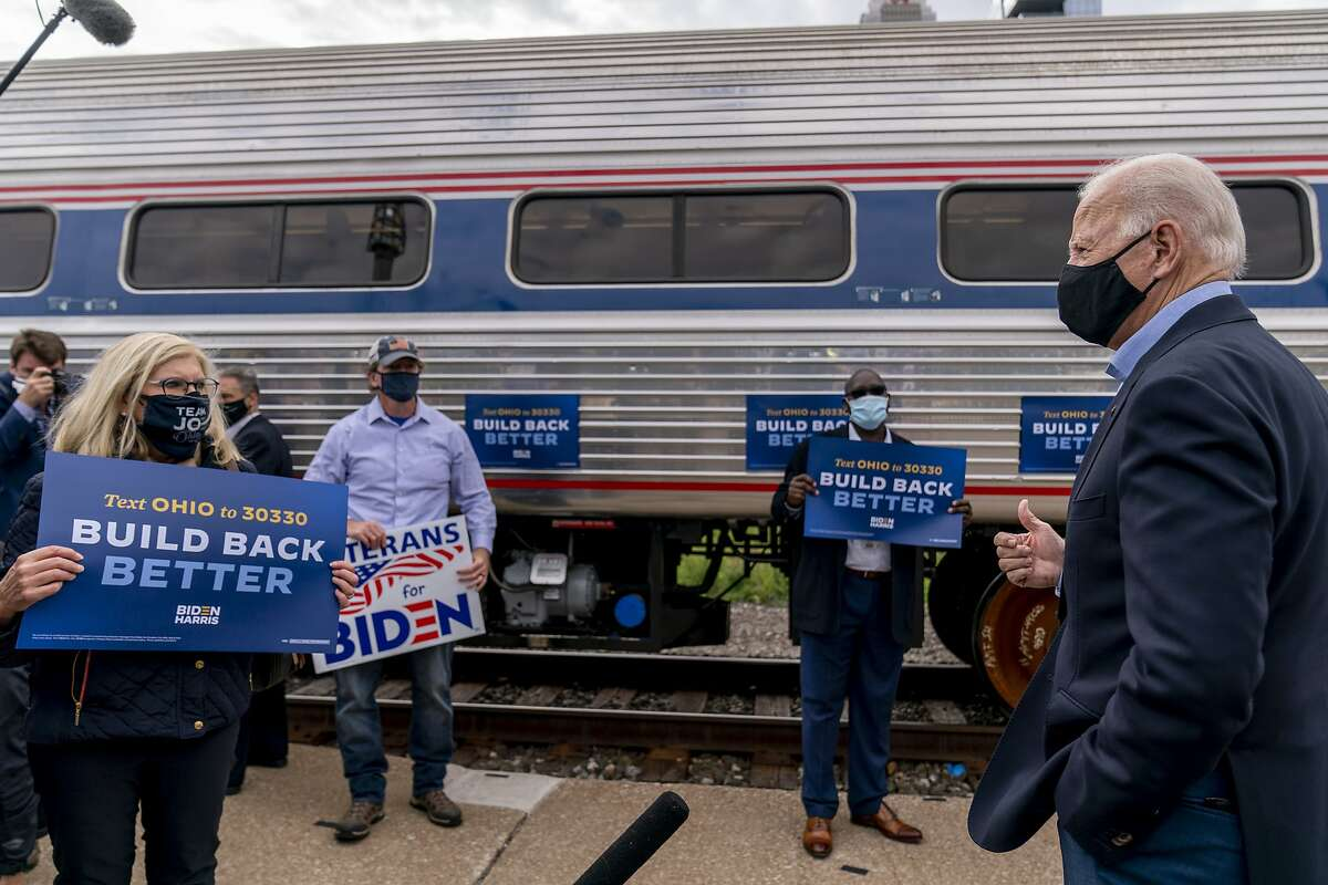 Democratic presidential candidate Joe Biden speaks to supporters before boarding his train at a Cleveland station.