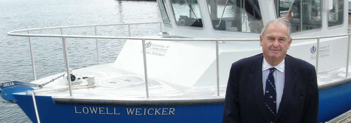 Former Connecticut Gov. Lowell Weicker in front of the research vessel named after him. Now a marine science center at the Avery Point campus will bear his name.