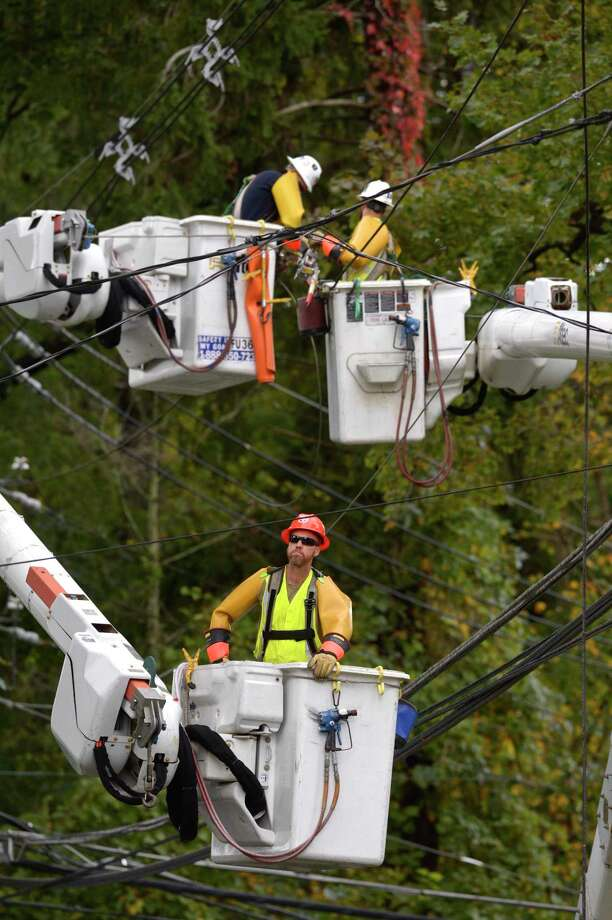 Crews work on downed power lines on South Street in Bethel on Wednesday. A violent storm that moved through the area overnight knocked out power. Photo: H John Voorhees III / Hearst Connecticut Media / The News-Times