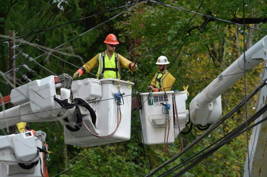 Crews work on downed power lines on South Street, at Oakland Heights, in Bethel, Conn, on Wednesday, September 30, 2020. Power was out in multiple locations due to a storm that moved through the area overnight. Photo: H John Voorhees III / Hearst Connecticut Media / The News-Times