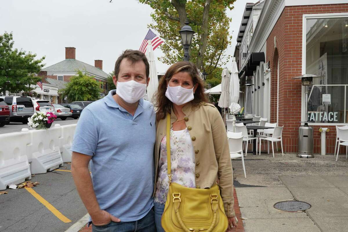 Justin and Monica Aronson of New Canaan wearing their masks on Elm Street in New Canaan last year.