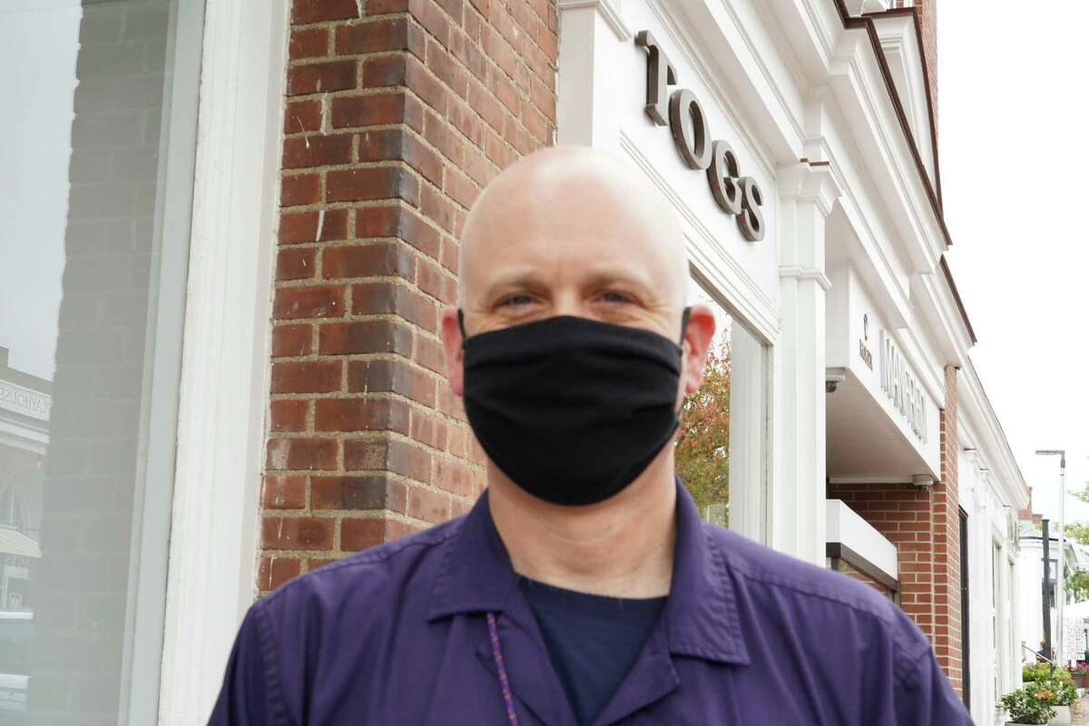 Ken Jones was obeying the law by wearing his mask on Elm Street in New Canaan on Tuesday, Sept. 29, 2020.