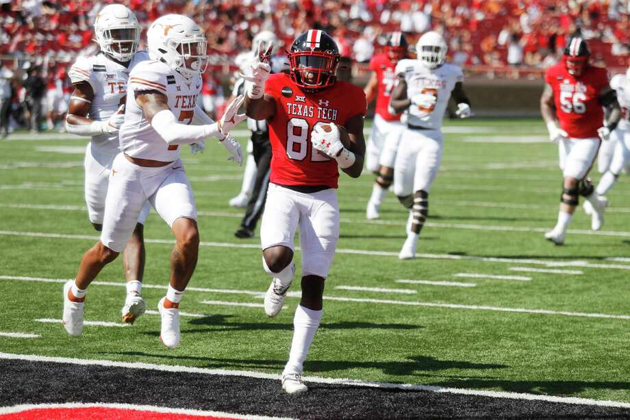 Texas Tech wide receiver Kesean Carter holds up two fingers as he scored his second touchdown of the game during the first half of an NCAA college football game against Texas Tech, Saturday Sept. 26, 2020, in Lubbock, Texas. (AP Photo/Mark Rogers) Photo: Mark Rogers, FRE / Associated Press / Copyright 2020 The Associated Press. All rights reserved