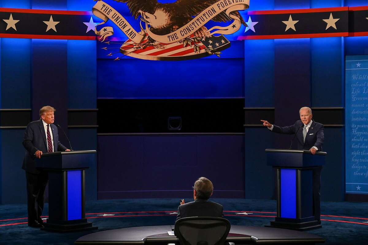US President Donald Trump (L) and Democratic Presidential candidate and former US Vice President Joe Biden exchange arguments during the first presidential debate at Case Western Reserve University and Cleveland Clinic in Cleveland, Ohio, on September 29, 2020. (Photo by Jim WATSON / AFP) (Photo by JIM WATSON/AFP via Getty Images)