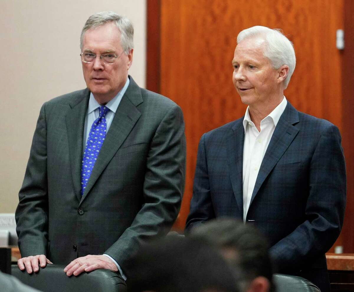 Defense attorney Tim Johnson, left, and Richard Rowe, Arkema CEO, right, are shown during the Arkema Inc. criminal trial at Harris County Criminal Courthouse, Monday, March 2, 2020, in Houston. Arkema Inc., a subsidiary of a French chemical manufacturer, along with three senior staff members are on trial over a fire at the Crosby chemical plant that was overwhelmed by Hurricane Harvey's flooding in 2017.
