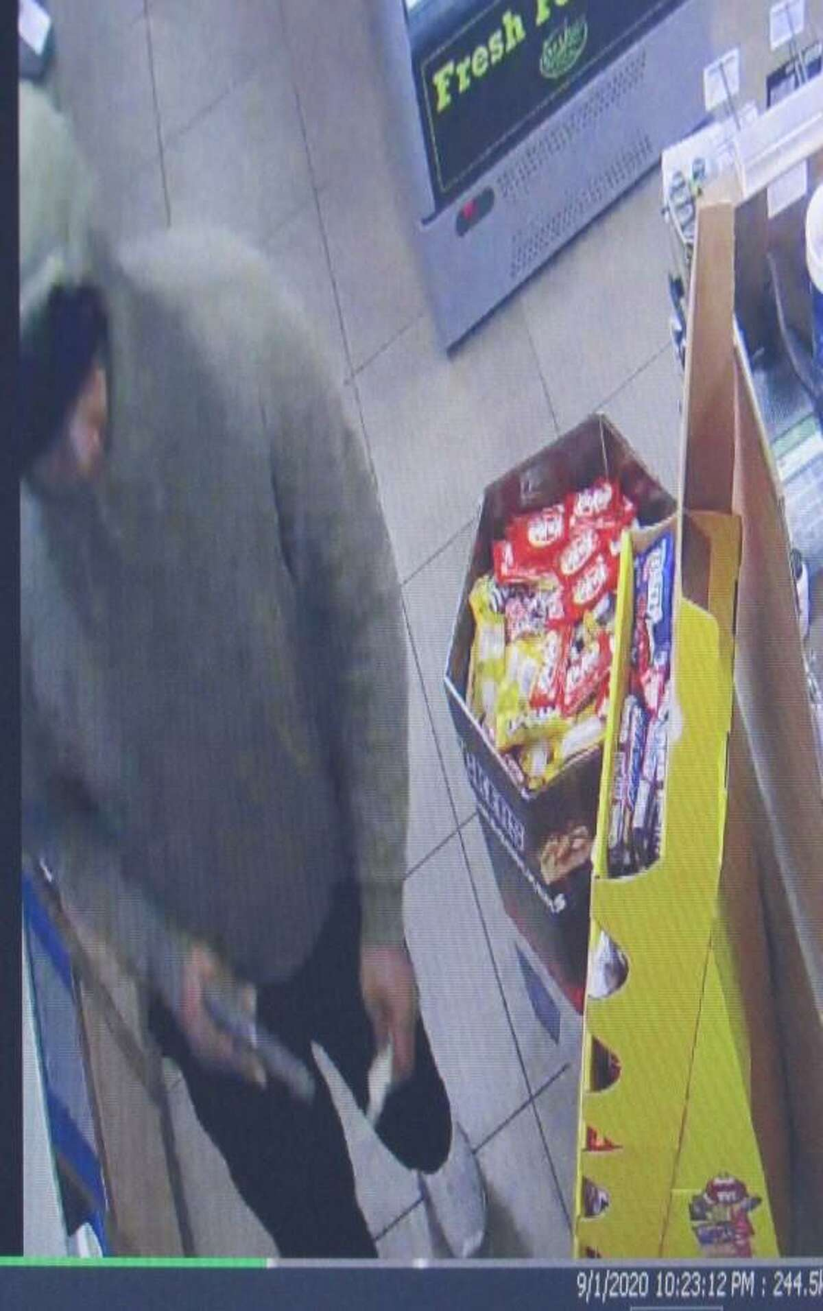 This surveillance camera still shows the robbery of the Murphy USA on Sept. 1, 2020.