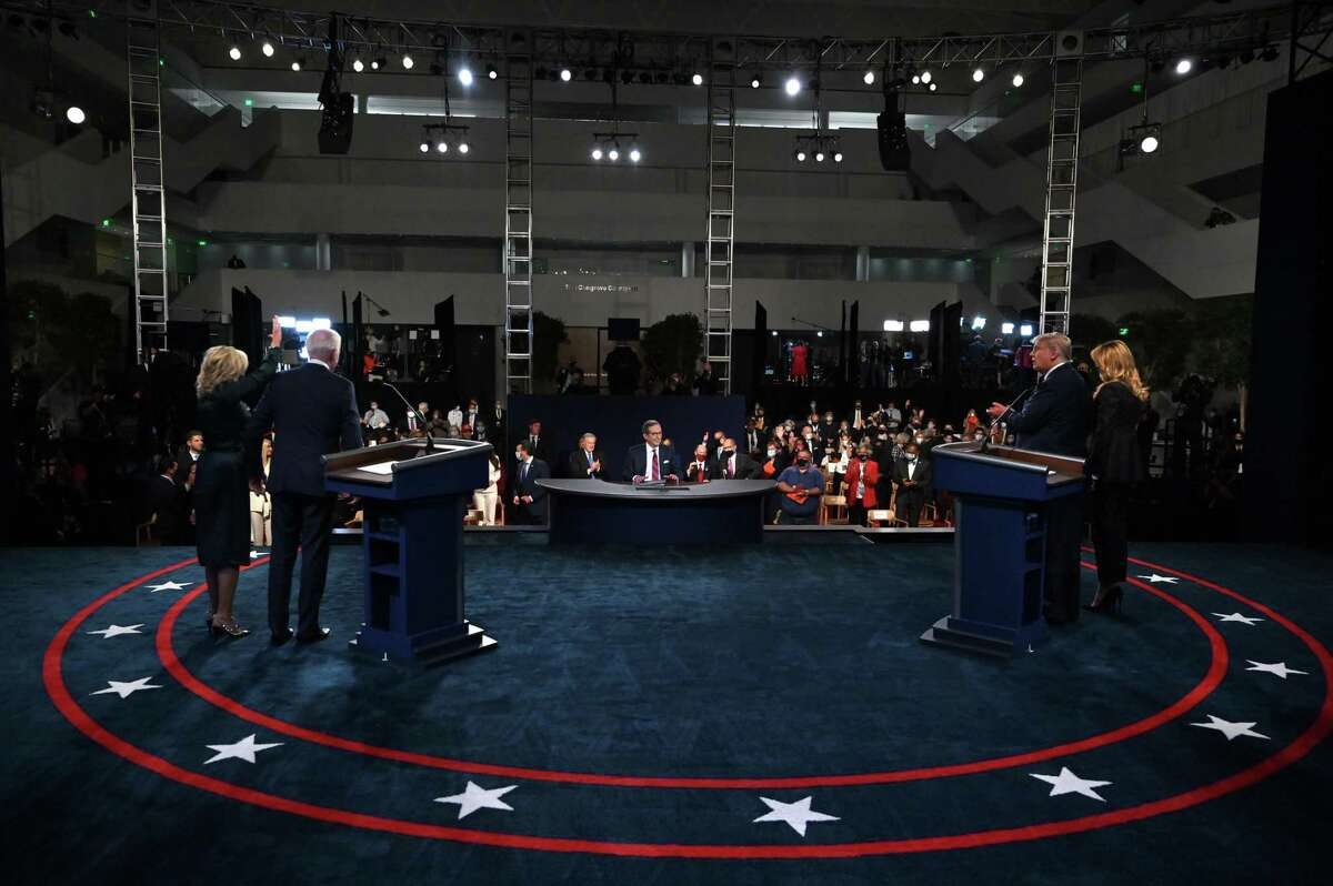 CLEVELAND, OHIO - SEPTEMBER 29: Former Vice President Democratic presidential nominee Joe Biden and his wife Dr. Jill Biden (L) stand on stage with U.S. President Donald Trump and first lady Melania Trump (R) and moderator Chris Wallace after the first presidential debate at the Health Education Campus of Case Western Reserve University on September 29, 2020 in Cleveland, Ohio. This is the first of three planned debates between the two candidates in the lead up to the election on November 3. (Photo by Olivier Douliery-Pool/Getty Images)