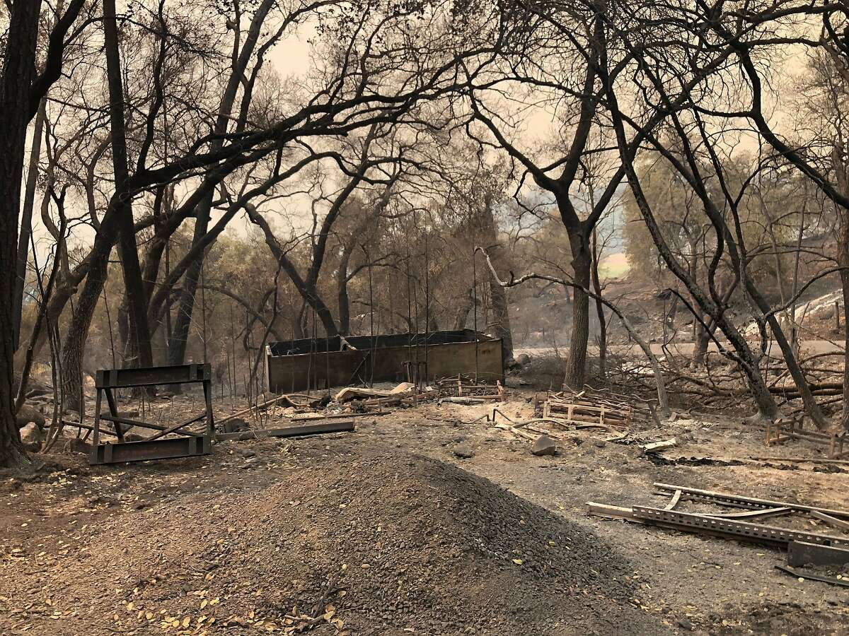 The ghostly remnants of what appear to have been a machine shed at the Deer Park location on North Fork Crystal Springs Road that Cal Fire believes is the origin point for the Glass Fire.