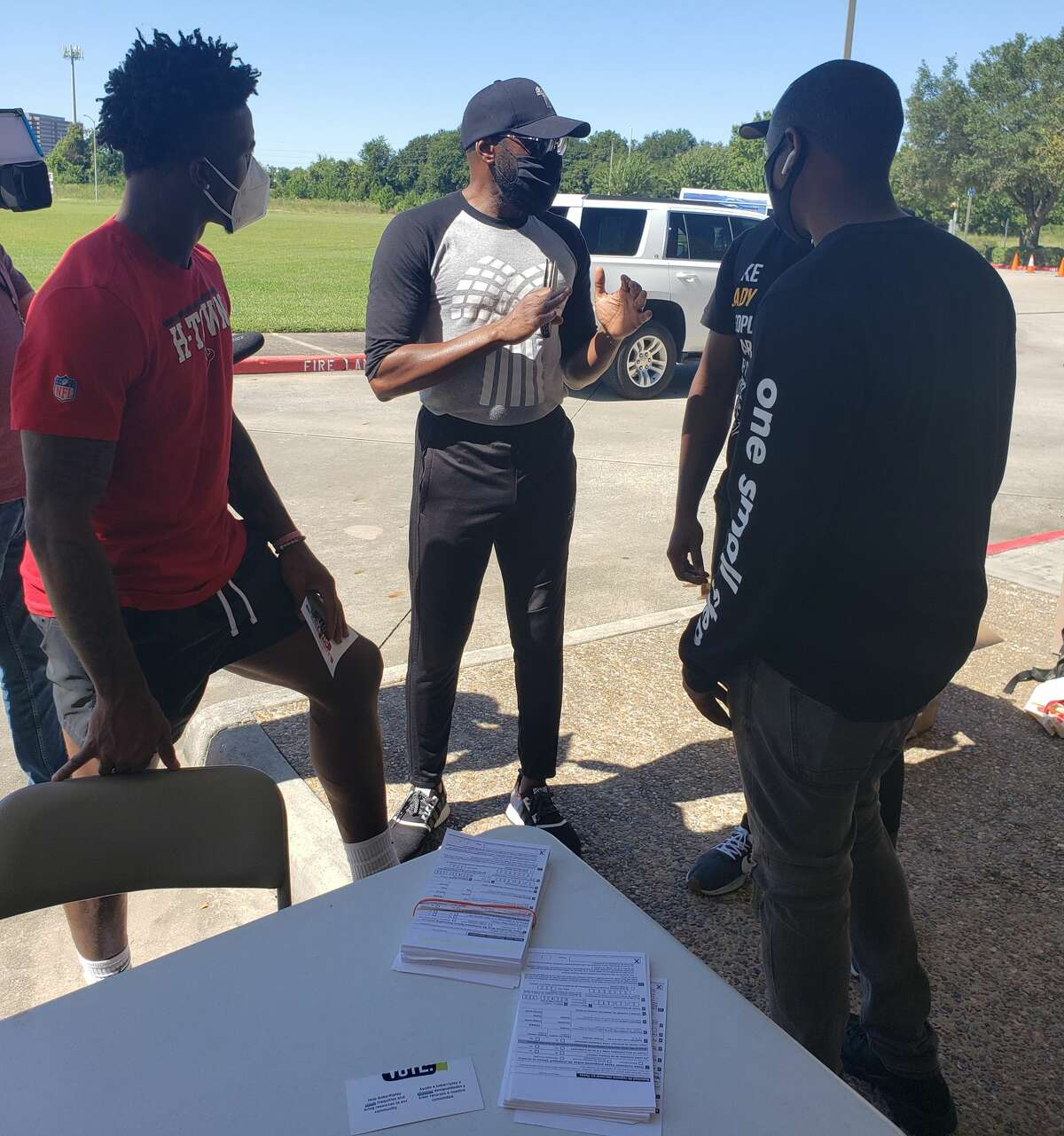 Texans outside linebacker Jacob Martin handed out several boxes of food on his day off Tuesday at Harvest Time Church.