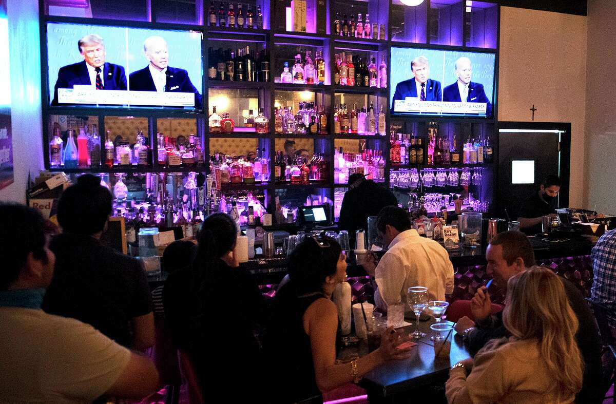 Potential voters and their family gather at Rocha's Bar and Grill to watch the presidential debate, Tuesday, Sep. 29, 2020.