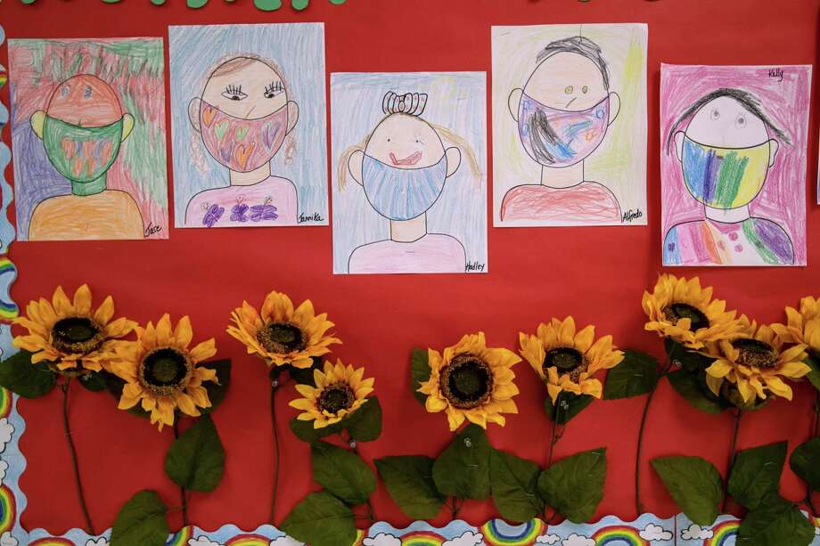 Drawings of children wearing masks decorate a hallway at Stark Elementary School in Stamford on Sept. 16. Photo: John Moore / Getty Images / 2020 Getty Images