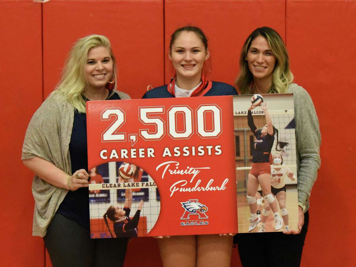 Atascocita's Trinity Funderburk reached the 2,500 assists milestone Tuesday night against Humble to open District 21-6A play. Coach Dani Walker (far left) and her mother Humble coach Michelle Funderburk (right) pose for a picture after the match.