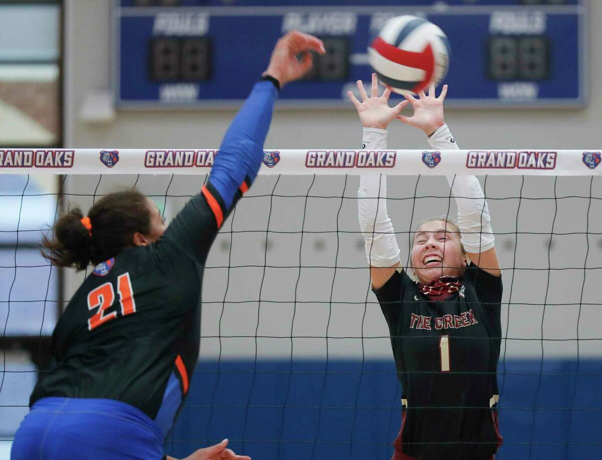 Summer Creek setter Jozie Dhayer (1) attempts a block against Grand Oaks outside hitter Fallon Thompson (21) during a non-district high school volleyball match at Grand Oaks High School, Tuesday, Sept. 29, 2020, in Spring.