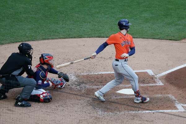 Houston Astros Kyle Tucker (30) hits an RBI single, scoring Michael Brantley during the fourth inning of Game 2 of an MLB Wild Card game at Target Field, Wednesday, September 30, 2020, in Minneapolis.