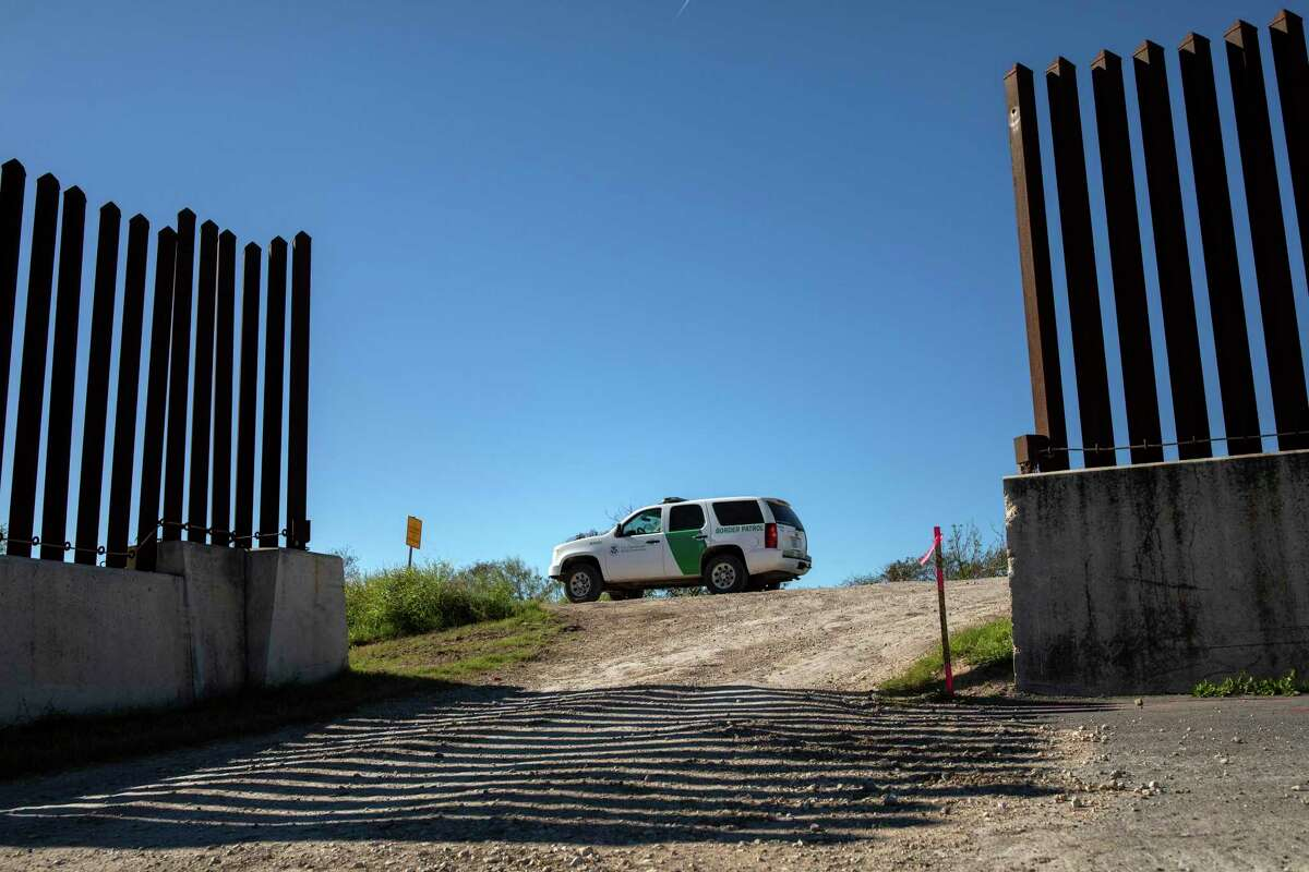 A Border Patrol vehicle parked at an opening in the fence near Brownsville, Texas, Jan. 20, 2019.
