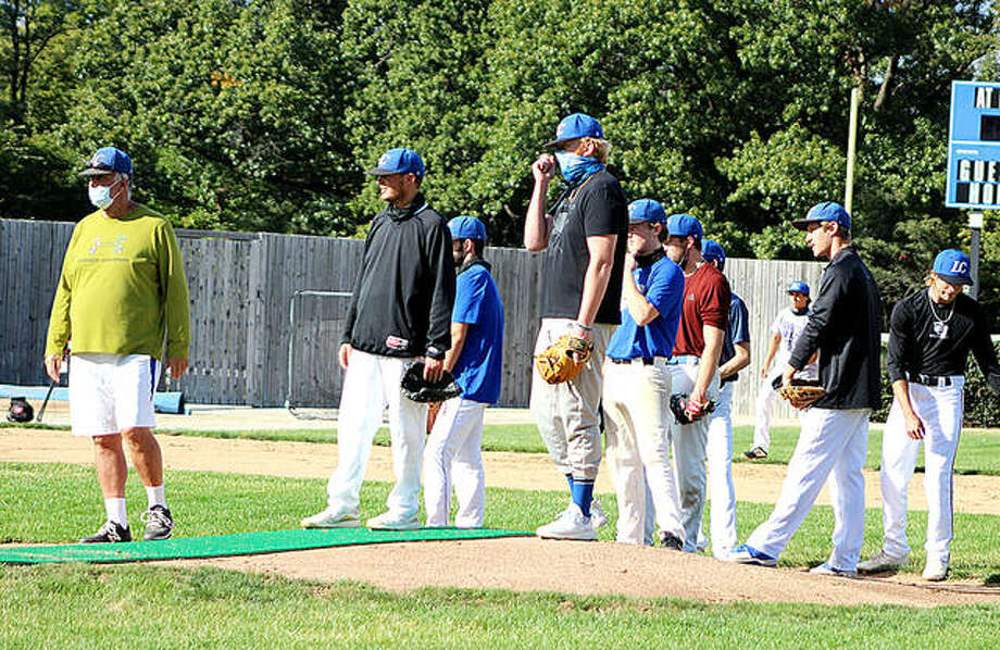 Lewis and Clark Community College baseball coach Randy Martz, far left, watches as pitchers go through a fielding drill during a fall practice session this week at the LCCC home field in Godfrey. Photo: Pete Hayes | The Telegraph