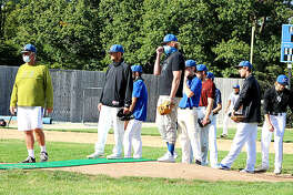 Lewis and Clark Community College baseball coach Randy Martz, far left, watches as pitchers go through a fielding drill during a fall practice session this week at the LCCC home field in Godfrey.