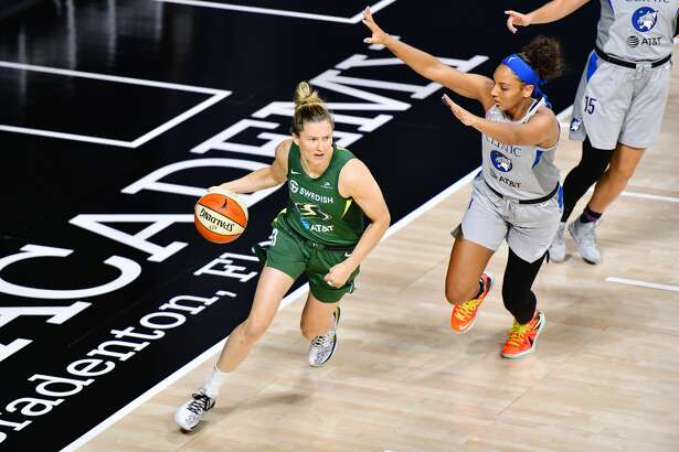 PALMETTO, FLORIDA - SEPTEMBER 24: Sami Whitcomb #33 of the Seattle Storm dribbles around Mikiah Herbert Harrigan #21 of the Minnesota Lynx during the first half of Game Two of their Third Round playoff at Feld Entertainment Center on September 24, 2020 in Palmetto, Florida. NOTE TO USER: User expressly acknowledges and agrees that, by downloading and or using this photograph, User is consenting to the terms and conditions of the Getty Images License Agreement. (Photo by Julio Aguilar/Getty Images)