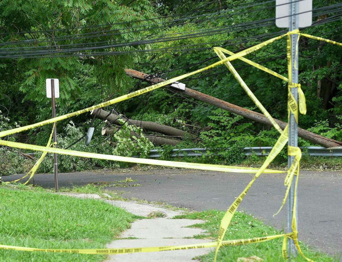 A downed utility pole on Taylor Street on August 7, 2020 in Stamford, Connecticut. Utility crews have been working to fix broken poles and clear fallen trees from lines, in an effort to restore power to the region in the wake of damage caused by Tropical Storm Isaias .