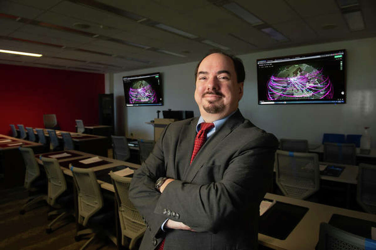 Dr. Tim Jacks stands in the cybersecurity classroom at Southern Illinois University Edwardsville. The school will now offer a Cybersecurity Specialization. The U.S. Department of Labor is projecting 0% unemployment for such professionals for the next five to seven years.