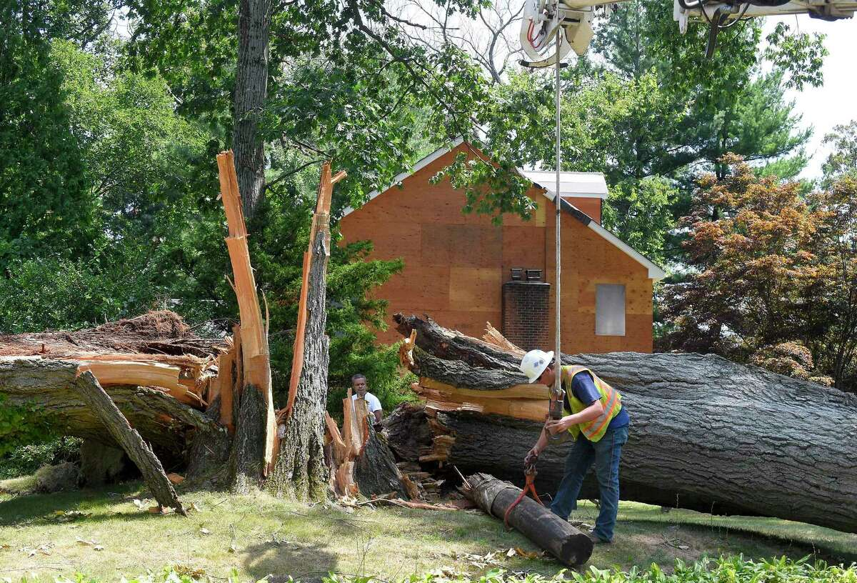 A utility crew worked in Stamford on August 11, in the wake of Tropical Storm Isaias.