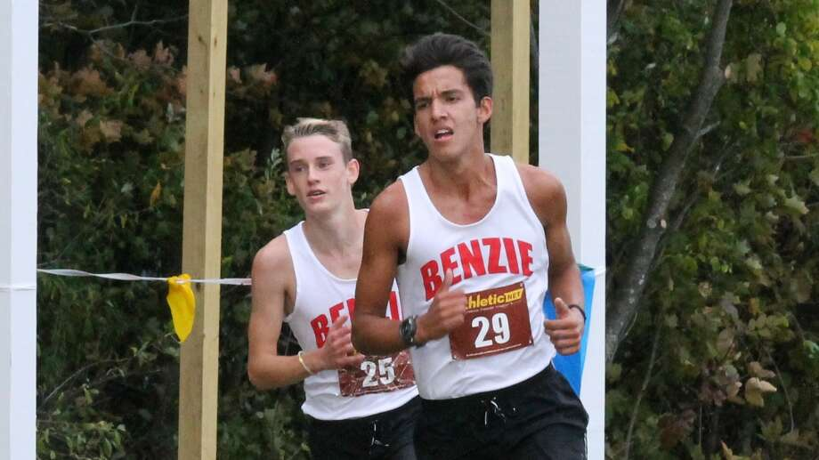 Craig Seger and Michael Musgrave turn in lifetime best times while placing third and fourth, respectively, at the Sept. 29 conference meet at Benzie Central. Photo: Robert Myers