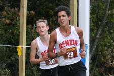 Craig Seger and Michael Musgrave turn in lifetime best times while placing third and fourth, respectively, at the Sept. 29 conference meet at Benzie Central.