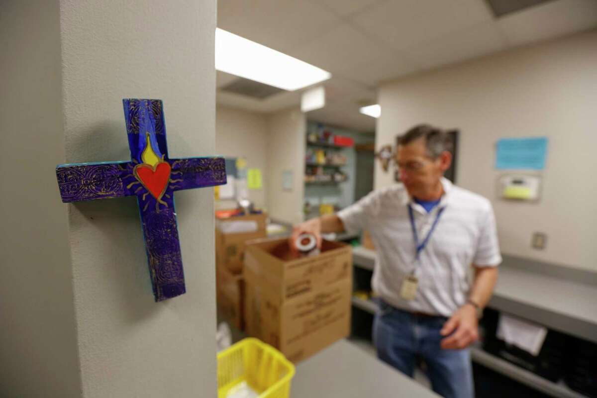A simple cross greets clients in the Christian Community Service Center food pantry program Thursday, Jan. 17, 2019, in Houston.