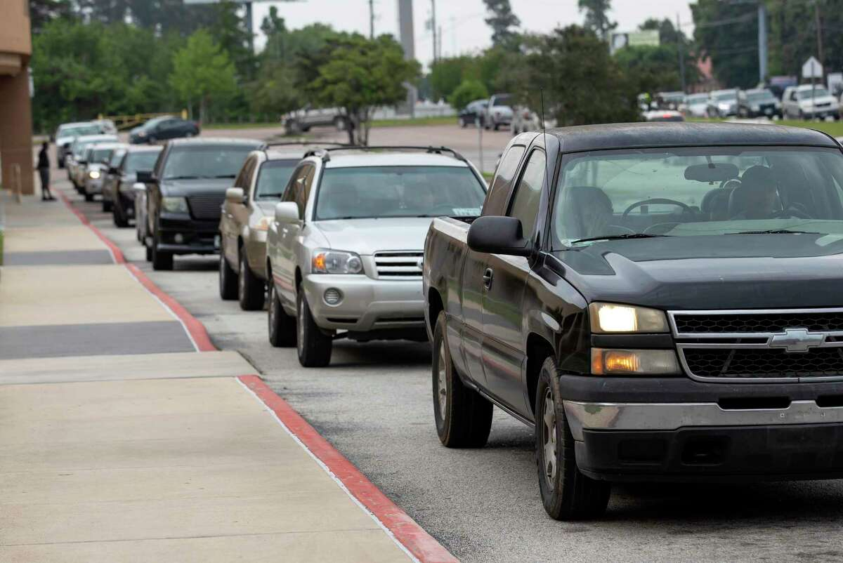 Vehicles wait in line during a lunch and breakfast food distribution at Conroe High School on April 9. With the approval of the United States Department of Agriculture, Conroe ISD will be offering free breakfast and lunch meals to all students in the district starting Thursday.