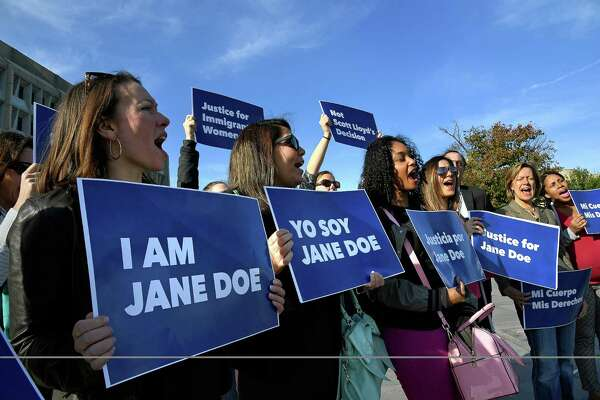 WASHINGTON, DC - Protesters in October 2017 oppose the Trump administration's earlier policy blocking young immigrants in federal custody from accessing abortion services.