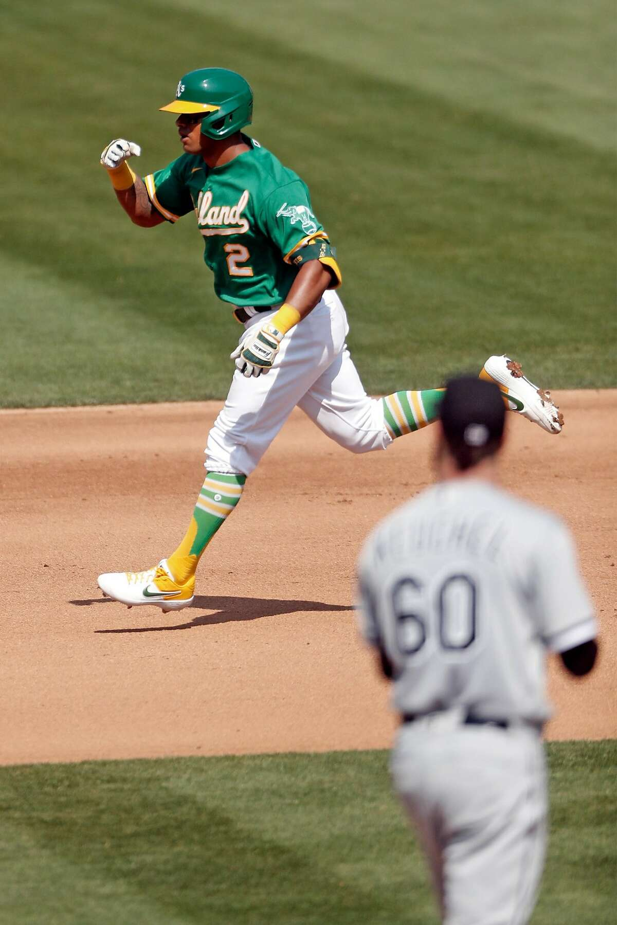 Oakland Athletics' Khris Davis reacts to his 4th inning solo home run against Chicago White Sox' Dallas Kuechel during American League Wild Card Series Game 2 at Oakland Coliseum in Oakland, Calif., on Wednesday, September 30, 2020.