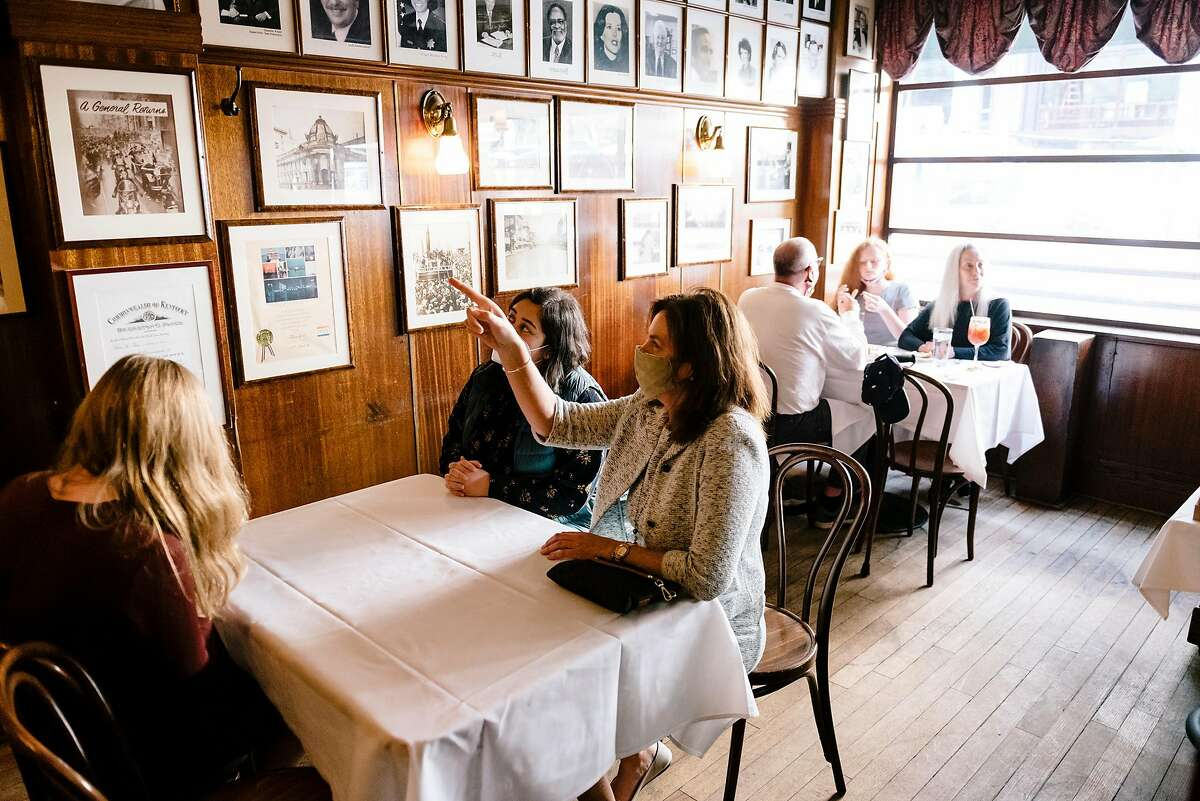 Guests at distanced tables dine at John's Grill in San Francisco in September when the city allowed restaurants to offer limited indoor dining in the orange tier of the reopening blueprint. It wasn't long before most of the Bay Area was back in the restrictive purple tier.