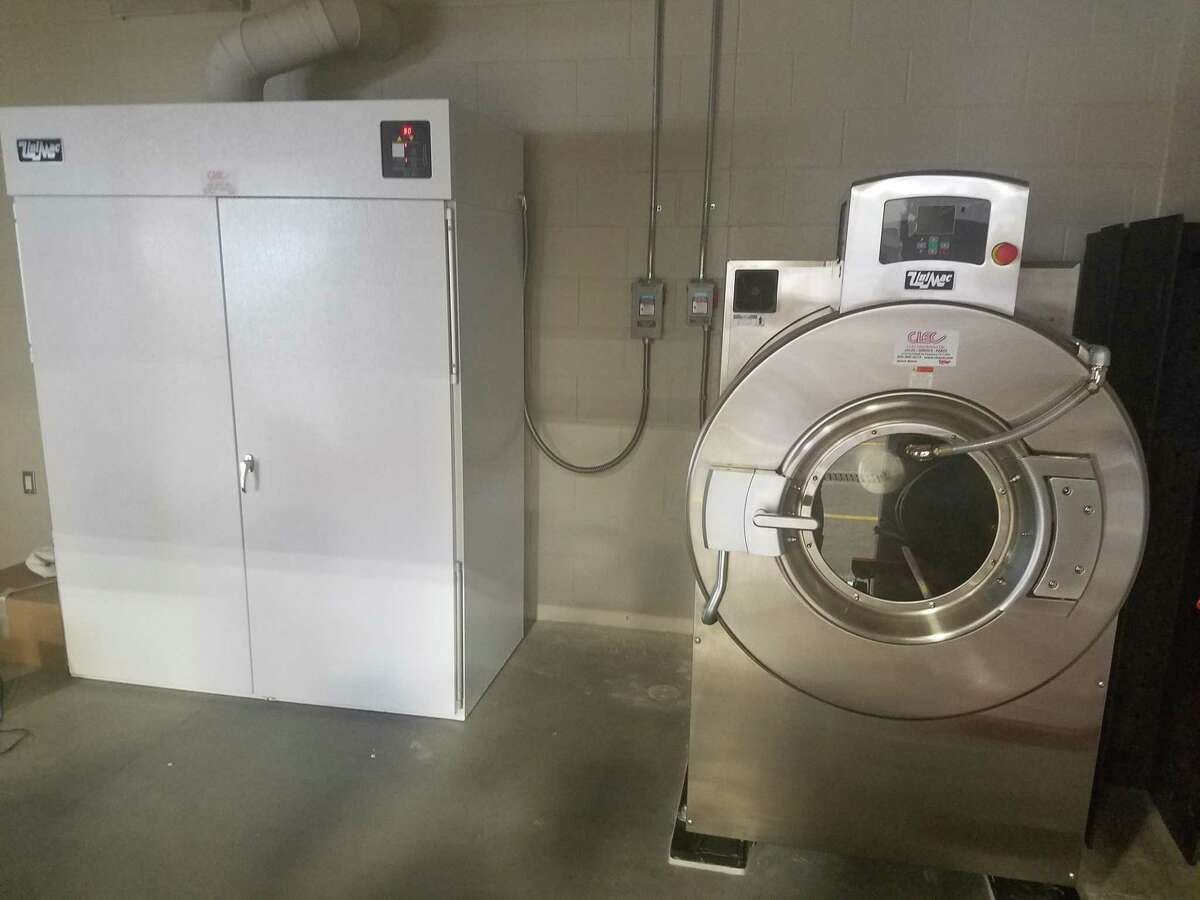 A state-of-the-art industrial washer and dryer clean chemicals and pathogens from gear.