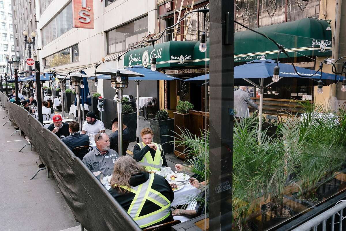 Guests eat outside at a parklet at John's Grill in San Francisco, Calif, on Wednesday, September 30, 2020. San Francisco moved to allow restaurants to offer indoor dining again for guests at a limit of twenty five percent capacity.