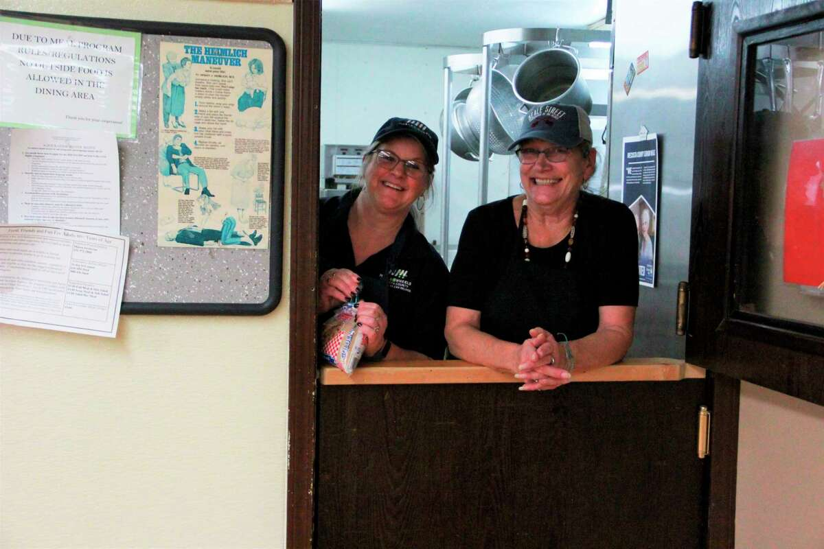 Among the many organizations impacted by the coronavirus, the Mecosta County Commission on Aging is in need of volunteers and workers to work at the COA in a number of programs. Featured is a photo of twovolunteers from last year's Thanksgiving Feast. (Pioneer file photo)