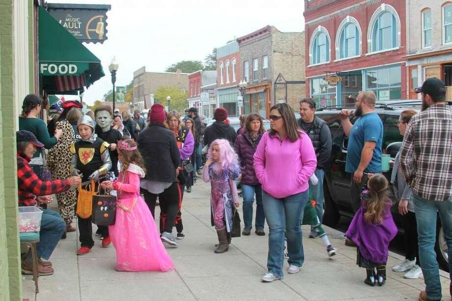 Families participate in trick-or-treating during Boos, Brews and Brats in 2019.The Manistee City Police Department encouraged people celebrating Halloween in Manistee this year adhere to public health recommendations from the District Health Department # 10 and the U.S. Center for Disease Control and Prevention. (File photo)
