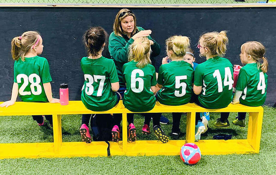 Alton Fighting Irish Soccer Club coach Jaime Dwiggins instructs her Under-8 girls team last season. The club has announced a series of special training sessions open to the public for four age groups, beginning with a group for toddlers ages 2 and 3. Photo: Pete Hayes | The Telegraph