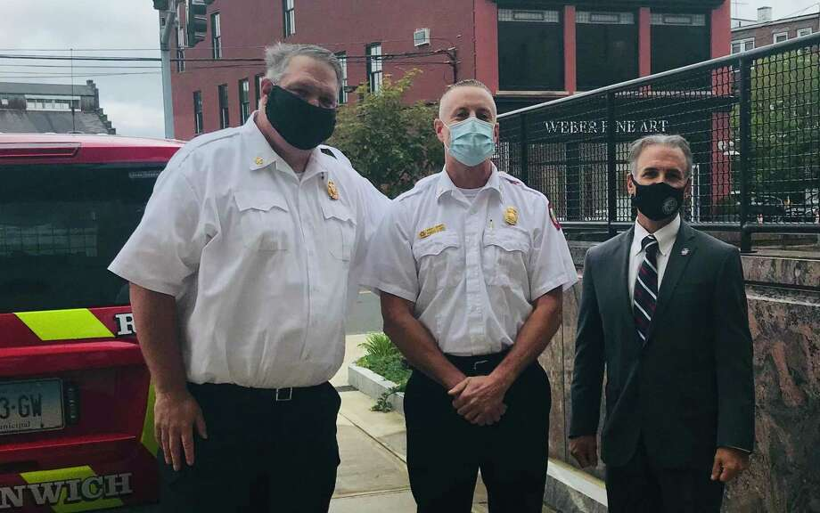 Assistant Fire Chief Robert Kick, center, is flanked by Fire Chief Joseph McHugh, left, and First Selectman Fred Camillo on Wednesday. Photo: / Contributed / Greenwich Fire Department