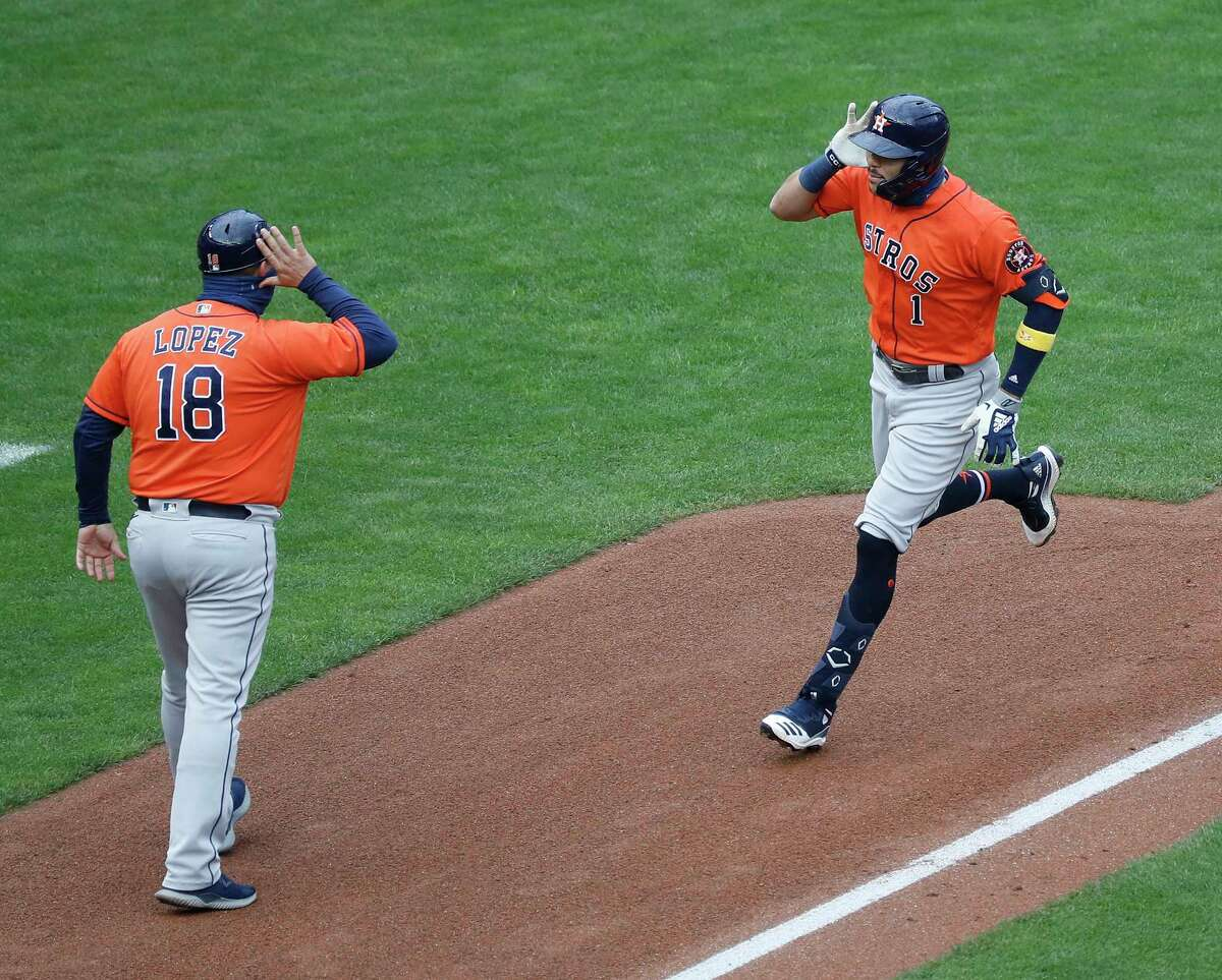 PHOTOS: More from the Astros' Game 2 win in Minnesota on Wednesday Houston Astros Carlos Correa (1) celebrates with third base coach Omar Lopez after hitting a solo home run during the seventh inning of Game 2 of an MLB Wild Card game at Target Field, Wednesday, September 30, 2020, in Minneapolis.