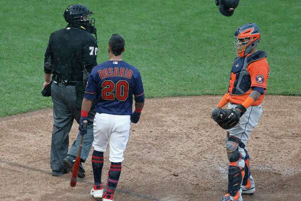 Minnesota Twins lEddie Rosario (20) throws his batting helmet and argues with home plate umpire Manny Gonzalez after getting called out on strikes during the sixth inning of Game 2 of an MLB Wild Card game at Target Field, Wednesday, September 30, 2020, in Minneapolis. Rosario was ejected.