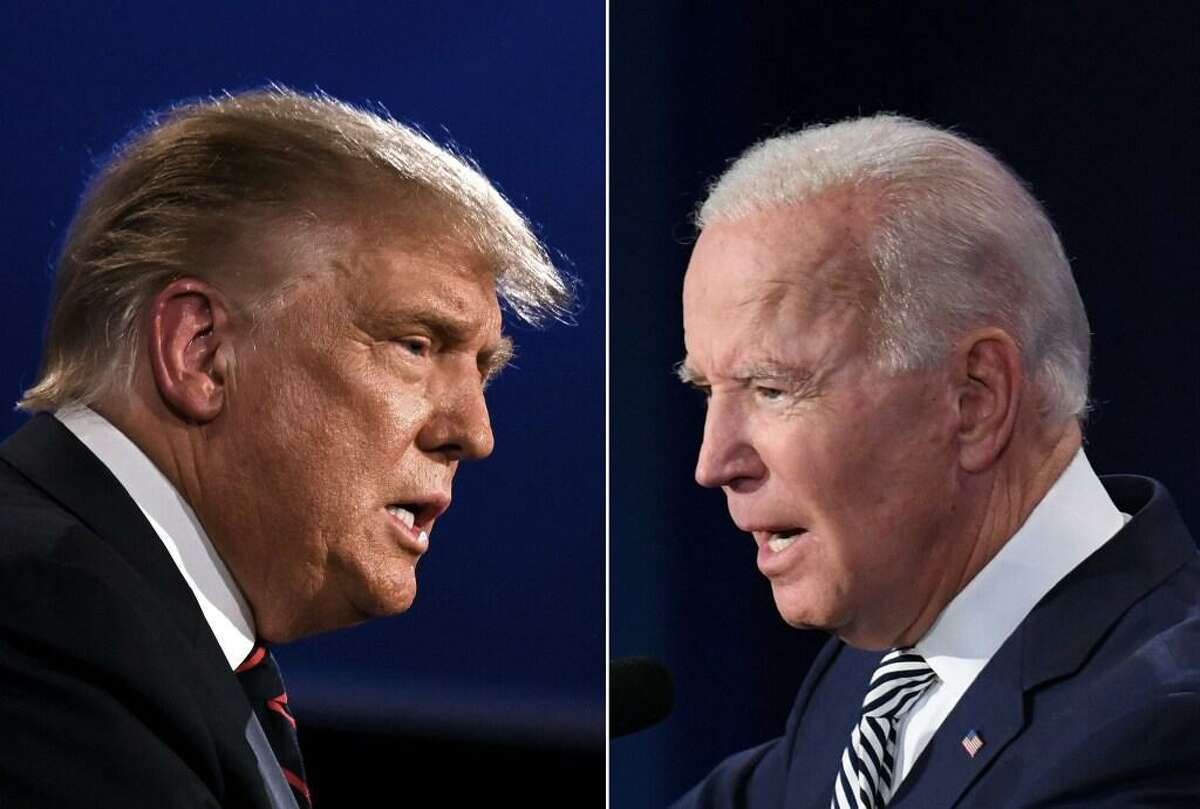 his combination of pictures created on September 29, 2020 shows US President Donald Trump (L) and Democratic Presidential candidate former Vice President Joe Biden squaring off during the first presidential debate at the Case Western Reserve University and Cleveland Clinic in Cleveland, Ohio on September 29, 2020.