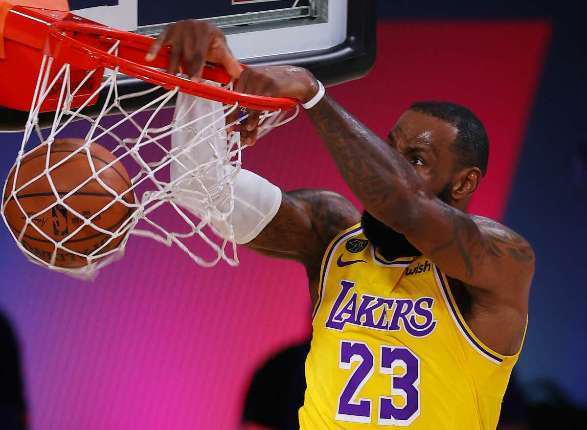 LAKE BUENA VISTA, FLORIDA - SEPTEMBER 18: LeBron James #23 of the Los Angeles Lakers dunks against the Denver Nuggets during the second quarter in Game One of the Western Conference Finals during the 2020 NBA Playoffs at AdventHealth Arena at the ESPN Wide World Of Sports Complex on September 18, 2020 in Lake Buena Vista, Florida. NOTE TO USER: User expressly acknowledges and agrees that, by downloading and or using this photograph, User is consenting to the terms and conditions of the Getty Images License Agreement. (Photo by Mike Ehrmann/Getty Images)