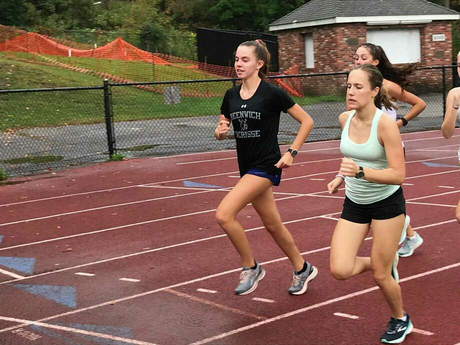 Mari Noble, right, is a senior captain of the Greenwich High School girls cross country team. She won the CIAC State Open girls cross country title in 2019. Photo: /
