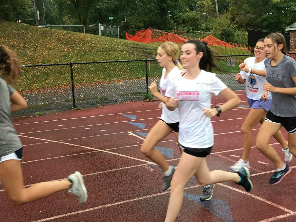 Eadaoin Clarke, front, runs during the Greenwich High School girls cross country team's practice on Tuesday, Sept. 29, 2020, in Greenwich, Connecticut. Clarke is one of the team's senior captains.