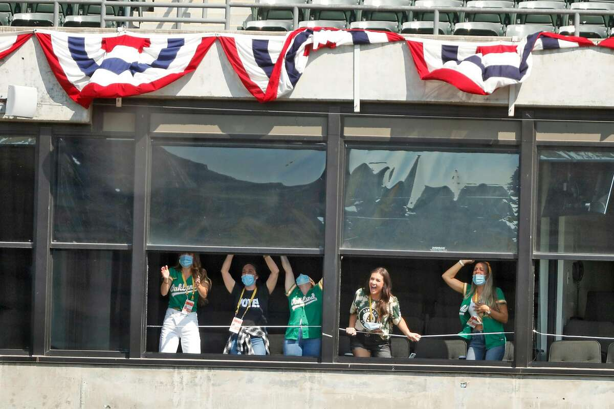 Oakland A's players' wives cheer a fourth inning home run by Khris Davis on the way to a playoff win over the Chicago White Sox on Wednesday at the Coliseum.